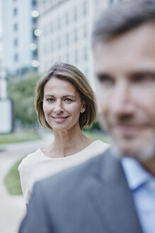 Portrait of confident businesswoman and businessman outdoors - RORF00917