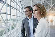 Businesswoman and businessman at the airport - RORF00941