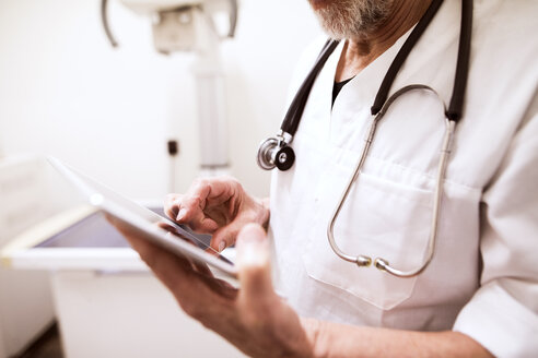 Close-up of vet using tablet in clinic - HAPF01702