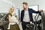Family in car dealership choosing family vehicle - ZEDF00666