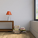 Vintage sideboard with table lamp and stack of books - UWF01256
