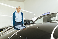 Customer looking at car in car dealership - ZEDF00715