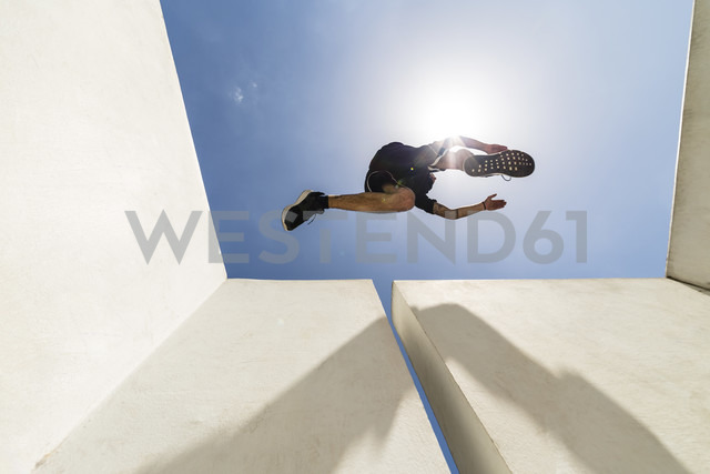 Man jumping in the city during a parkour session - MGIF00010