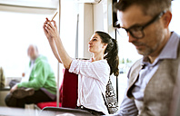Woman with smartphone taking a selfie in tram - HAPF01768