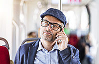 Man on smartphone in bus - HAPF01774