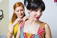 Fashion designer with client in studio - MGIF00043