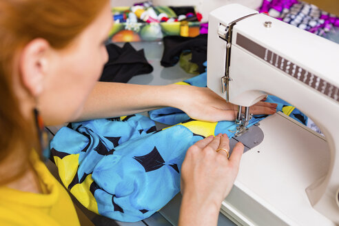Fashion designer working with sewing machine - MGIF00049