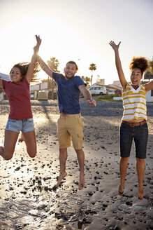 Happy friends jumping in the air on the beach - PACF00019