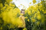 Girl standing in rape field - MOEF00006