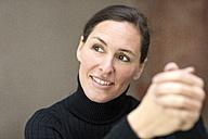 Smiling woman looking sideways - DMOF00041