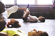 Three young people exercising in gym - HAPF01794