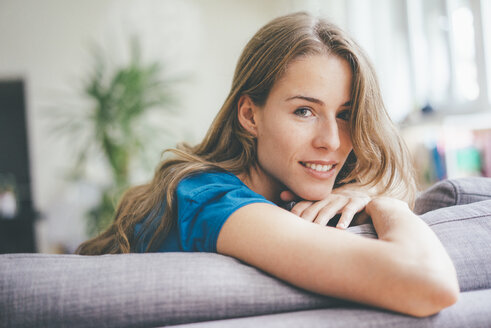 Portrait of young woman relaxing at home - KNSF01645