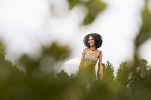 Smiling woman in nature - ABZF02162