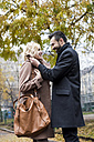 Happy business couple in the city - MAUF01092