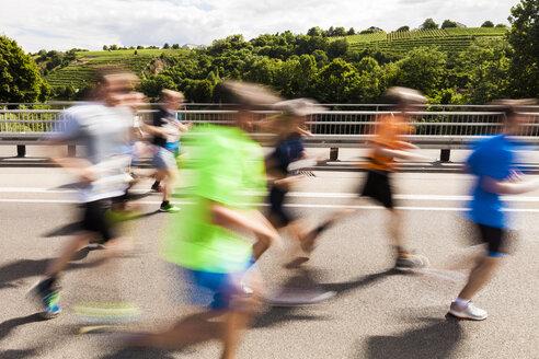 Germany, Baden-Wurttemberg, Stuttgart, Runners in motion during half marathon - WDF04048