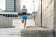Woman running in the city - UUF10936