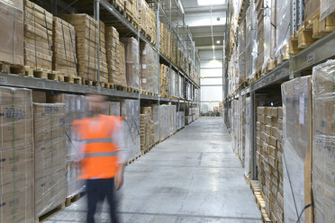 Man on the move in factory hall wearing safety - LYF00739