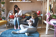 Young couple with kittens in the living room - RTBF00966