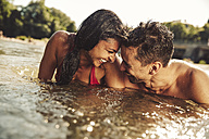 Happy couple bathing in river - SUF00151
