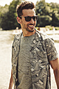 Portrait of smiling man wearing sunglasses - SUF00157