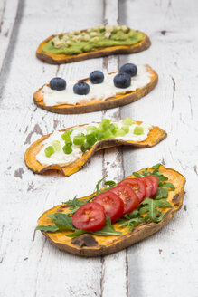 Toasted sweet potato slices garnished with various toppings - LVF06215