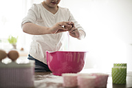 Girl separating eggs - MOEF00026