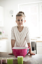 Portrait of little girl baking in the kitchen - MOEF00029