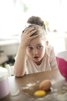 Portrait of embarrassed little girl in the kitchen - MOEF00041