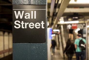 USA, New York, Manhattan, Wall street sign at underground station - MAUF01148