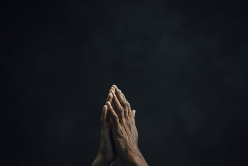 Hands of man and black background - KNSF01737