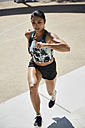 Fit woman running outdoors - SUF00190