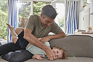 Father playing with little son at home - SUF00226