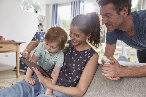 Happy family using tablet at home - SUF00229