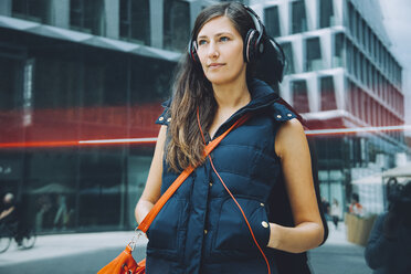 Young woman with headphones in the city - CHAF01911
