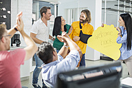 Colleagues cheering and welcoming injured friend back - ZEF14086