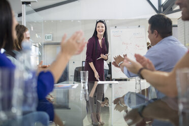 Applause for businesswoman leading a presentation - ZEF14098