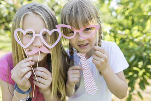 Two playful sisters in garden - SHKF00771