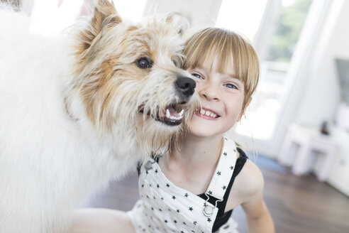 Happy girl with dog at home - SHKF00789