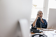 Businesswoman on the phone in office - KNSF01767