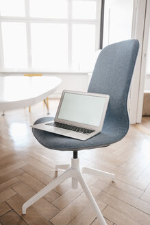 Laptop on chair in office - KNSF01848