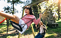 Three happy girls on a playground - MGOF03446