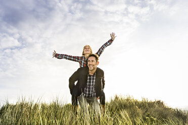 Happy playful couple in dunes - FMKF04254