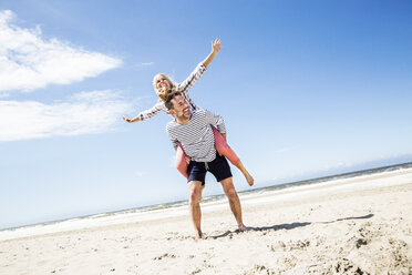 Happy playful couple on the beach - FMKF04302