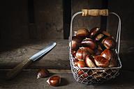 Sweet chestnuts in wire basket - EVGF03239