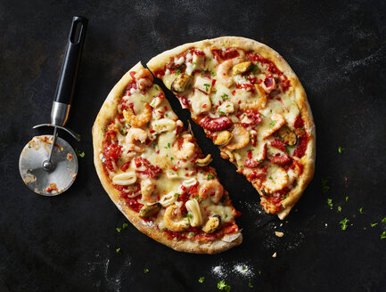 Sliced pizza with frutti di mare on dark ground - KSWF01820