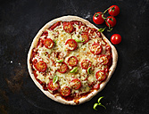 Pizza Margherita and cherry tomatoes on dark ground - KSWF01826