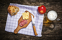 Snack with bread, cheese, salami, apple and glass of beer - DIKF00264