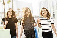 Three friends with shopping bags - GIOF02954