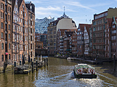 Germany, Hamburg, historic buildings at Nicolaifleet with Elbe Philharmonic Hall in the background - RJ00699