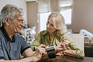 Smiling senior couple taking blood pressure - ZEDF00756